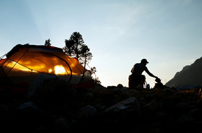 Dusk settles in at their camp near Pinto Lake, not long after making the multi-thousand foot drop from Black Rock Pass into the Cliff Creek valley. (Chris Jordan-Bloch / Earthjustice)
