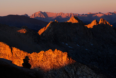 Sunset colors the dramatic view east from Sawtooth Pass towards a sea of towering peaks.