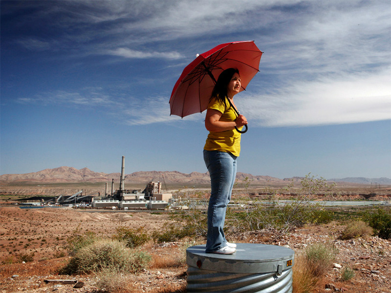 Vickie Simmons near the Reid Gardner coal-fired power plant in Nevada. For years, she and the rest of the Paiute tribe have lived in the shadow of Reid Gardner's smokestacks and waste pits.