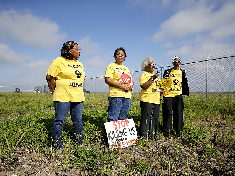 From left, RISE St. James members Myrtle Felton, Sharon Lavigne, Gail LeBoeuf and Rita Cooper conduct a live stream video on property owned by Formosa Plastics in St. James Parish, La., in 2020.