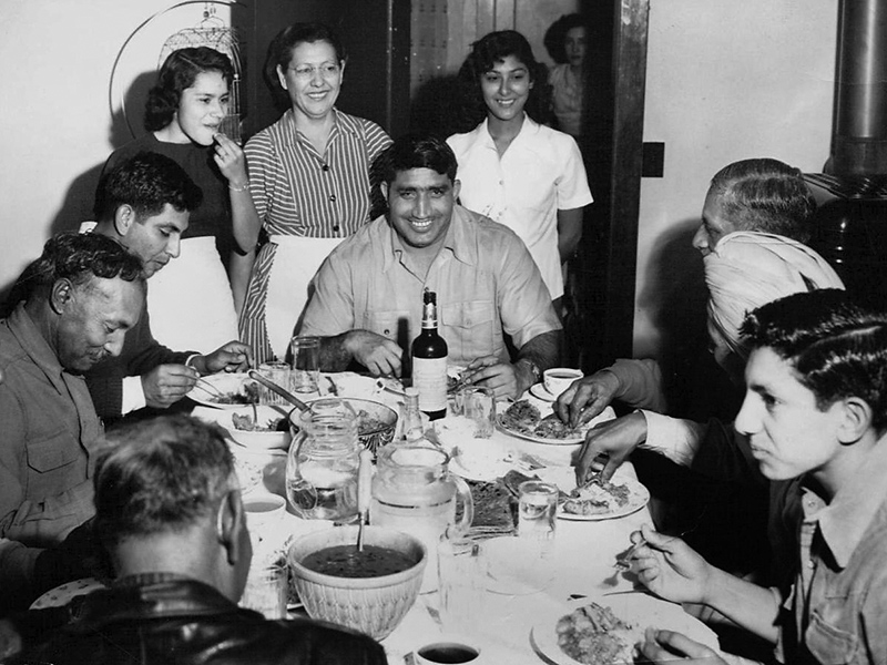 Dinner at the Phoenix home of Rosa and Jeevan Singh in 1951.  His guest at the center is Indian professional wrestler Tiger Joginder Singh.