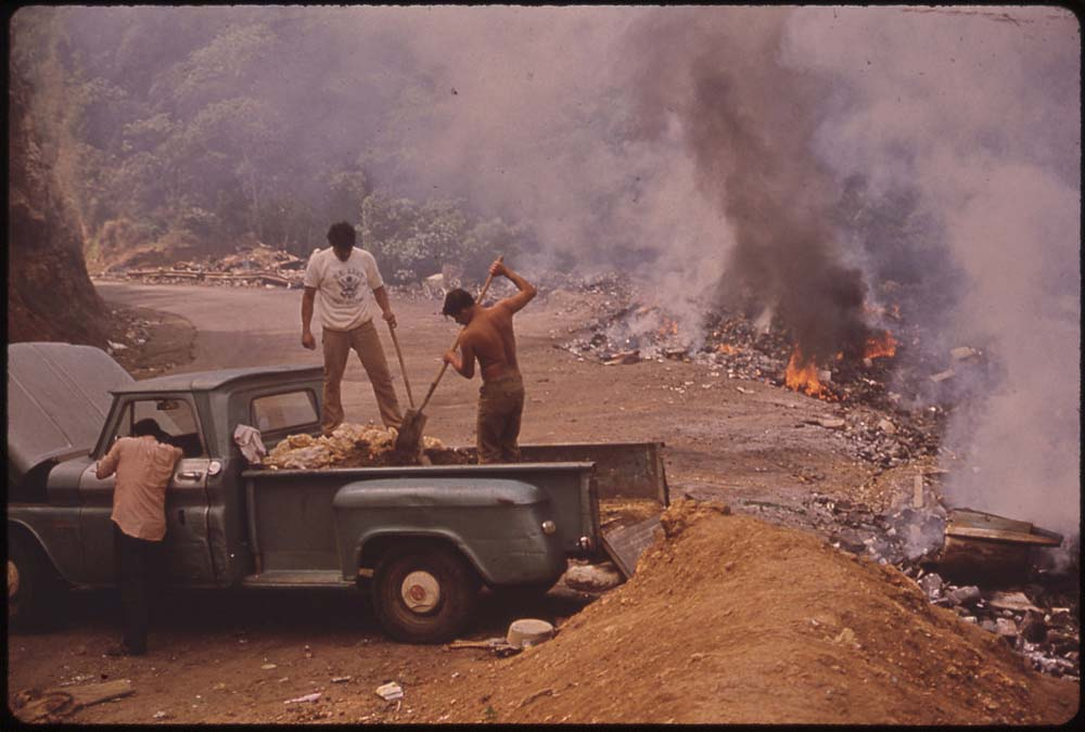 February, 1973: Garbage burns at an open dump on highway 112 near San Sebastian, Puerto Rico.