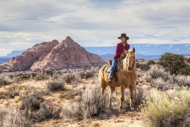 A woman horseback riding in Grand Staircase-Escalante National Monument. Secretary Zinke claimed that mining and drilling interests were not at the root of the decision to gut this monument. A Canadian mining company is now preparing to mine the lands stripped of monument protections.