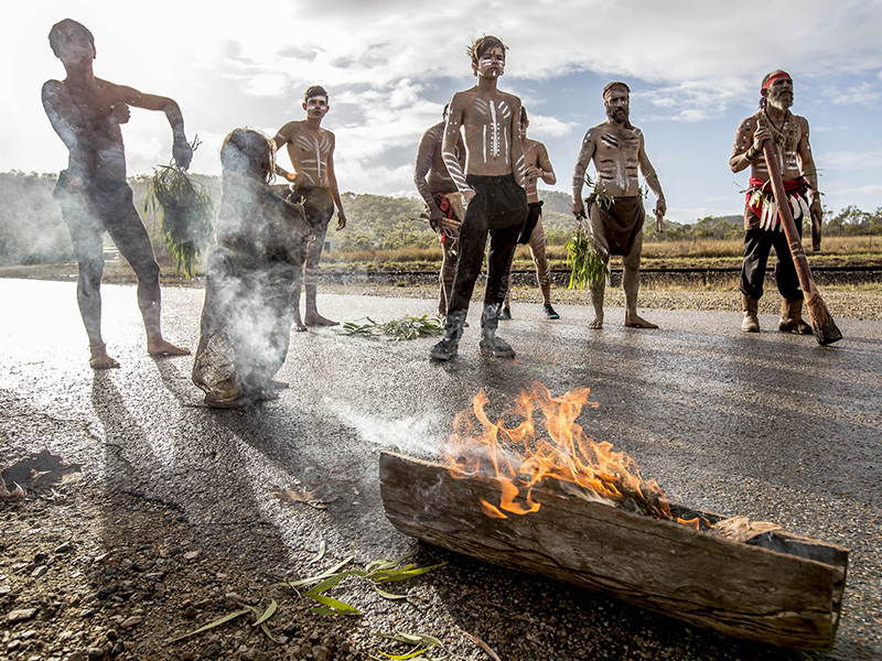 Indigenous Australians gather in a ceremony at Abbot Point in June 2015 to protest the proposed coal developments.