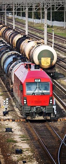 Railroad cars for transporting oil line up at a station. (Arvydas Kniuksta / Shutterstock)