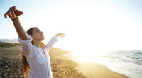 Breathing clean air at the beach. (iStock)