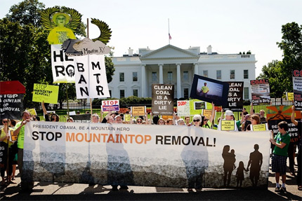 <b>Mountaintop Removal:</b> More than 13,500 passionate individuals uploaded their photo to our Mountain Heroes site, creating the largest photo petition to the president. Individuals rallied in front of the White House to present copies to administration officials. <i>Photo by Chris Jordan-Bloch.</i>