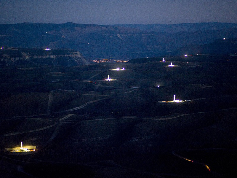 Drilling sites light up the night sky in Garfield County, Colorado.