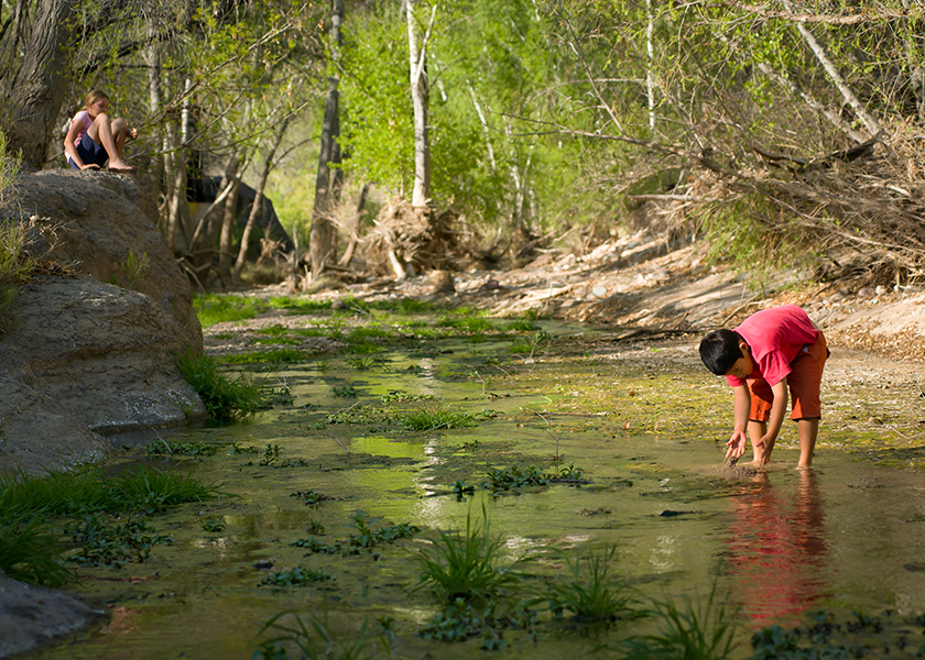The proposed Rosemont mine threatened Cienega Creek, where these children are playing.