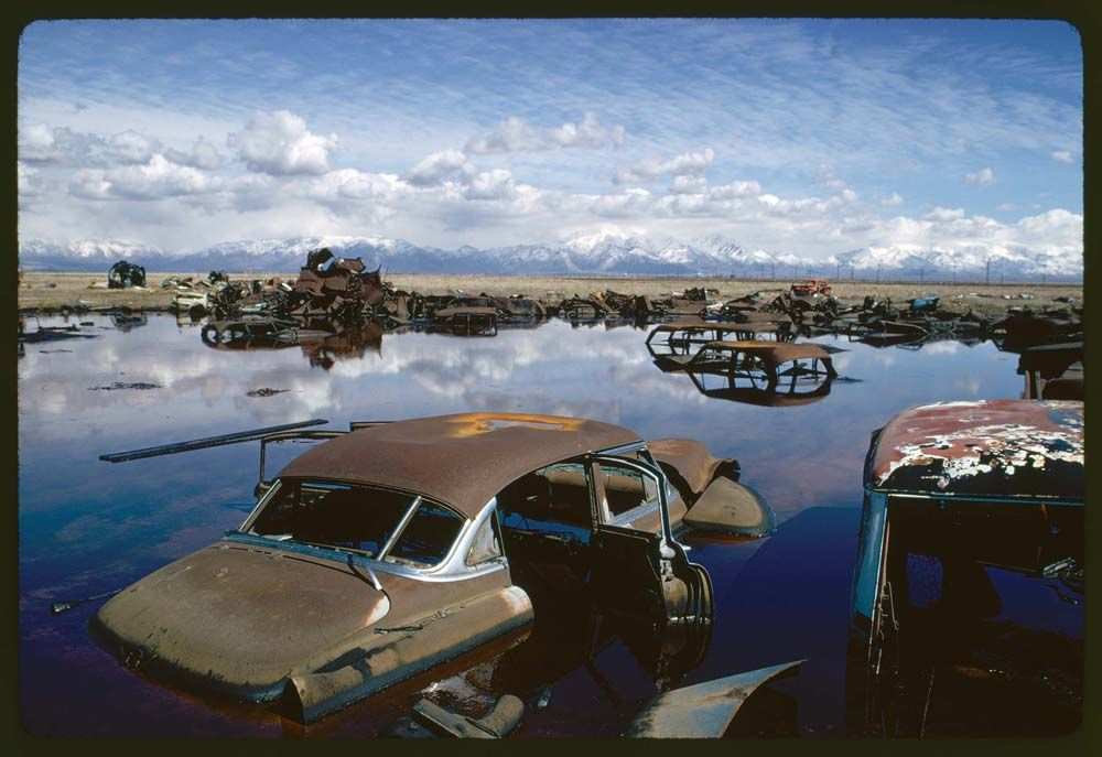 April, 1974: Abandoned automobiles and other debris clutter an acid water- and oil-filled five-acre pond near Ogden, Utah. The pond was cleaned up under EPA supervision to prevent possible contamination of the Great Salt Lake and a wildlife refuge nearby.
