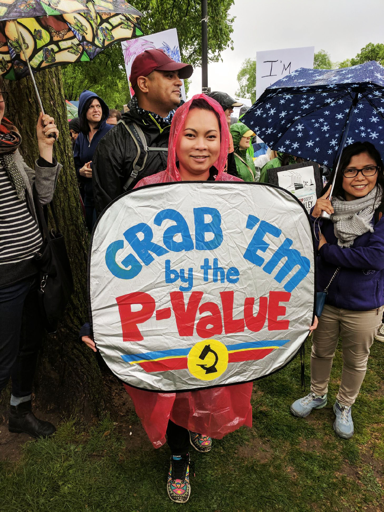 A participant in the March for Science shows off her sign.