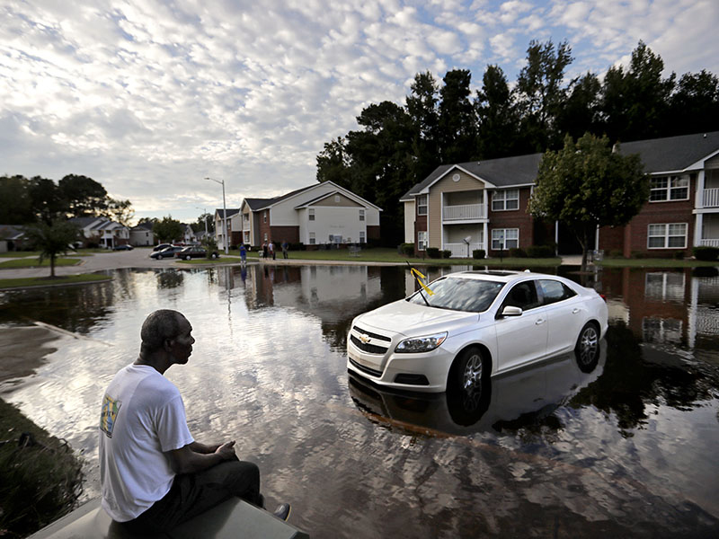 Augustin Dieudomme looks out at the flooded entrance to his Fayetteville, NC, apartment complex after Hurricane Florence.