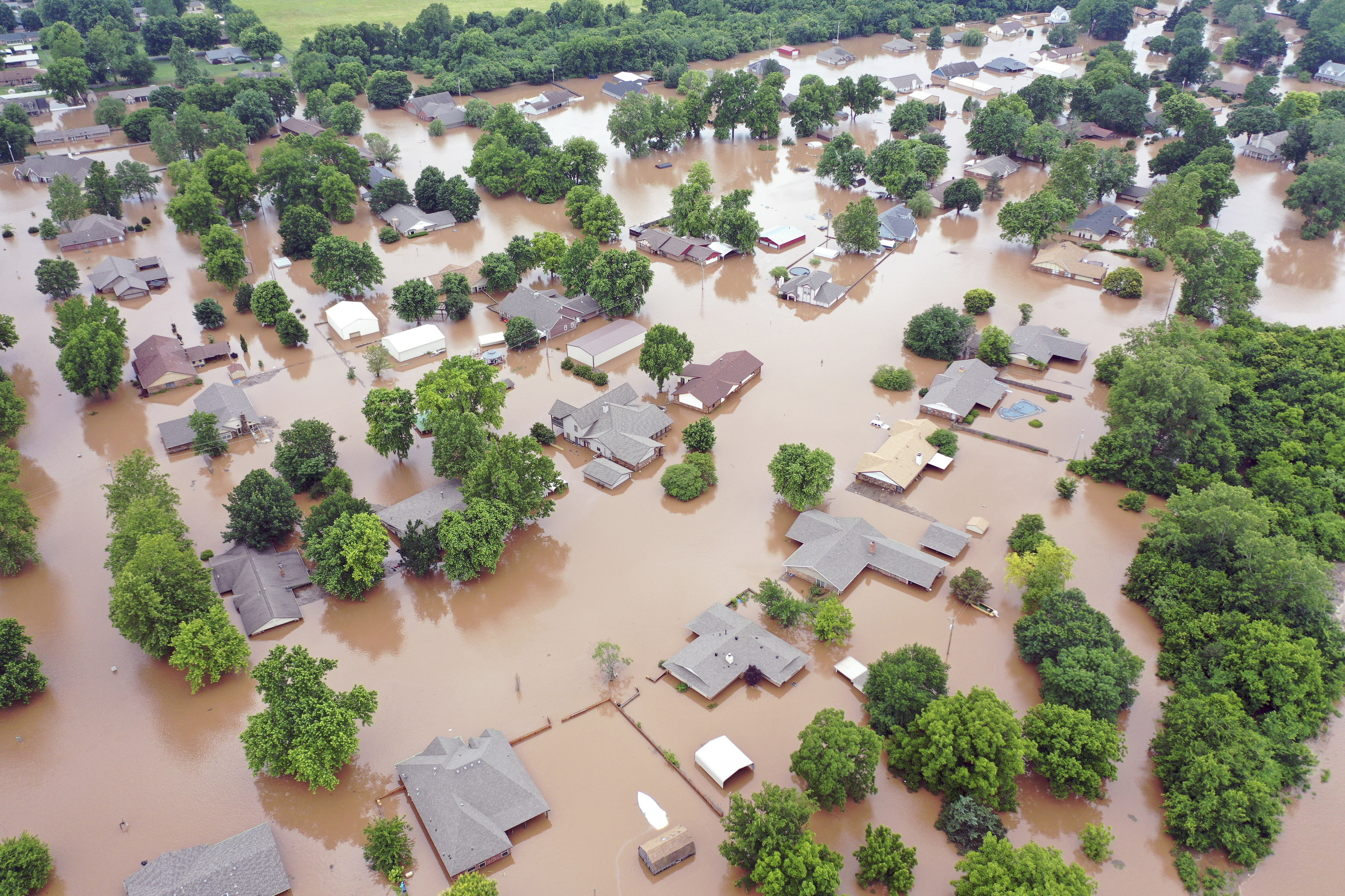 This Tuesday, May 28, 2019, aerial photo shows flooded homes along the Arkansas River in Sand Spring, OK.
