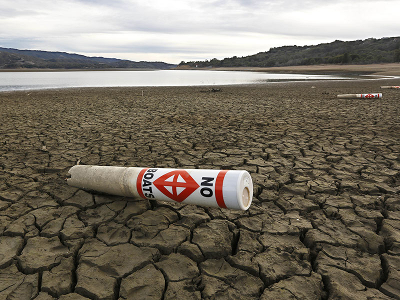 A warning buoy sits on the dry, cracked bed of Lake Mendocino near Ukiah, CA, in 2014.