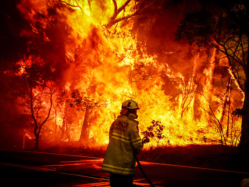 A firefighter tries to extinguish a bushfire on the outskirts of Bilpin, Australia, in December 2019.
