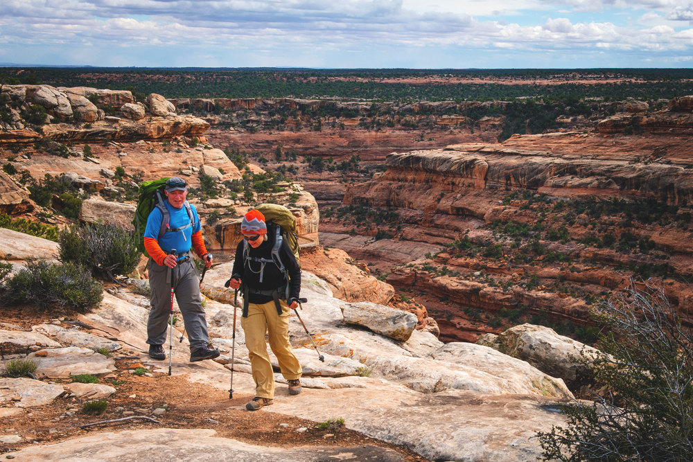 Two hikers trek through Bears Ears National Monument.