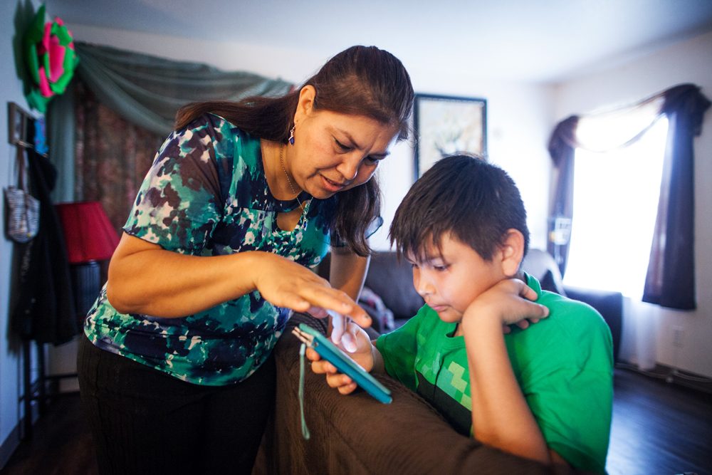 Claudia Angulo and her son Isaac in their home in Orange Cove, Calif.