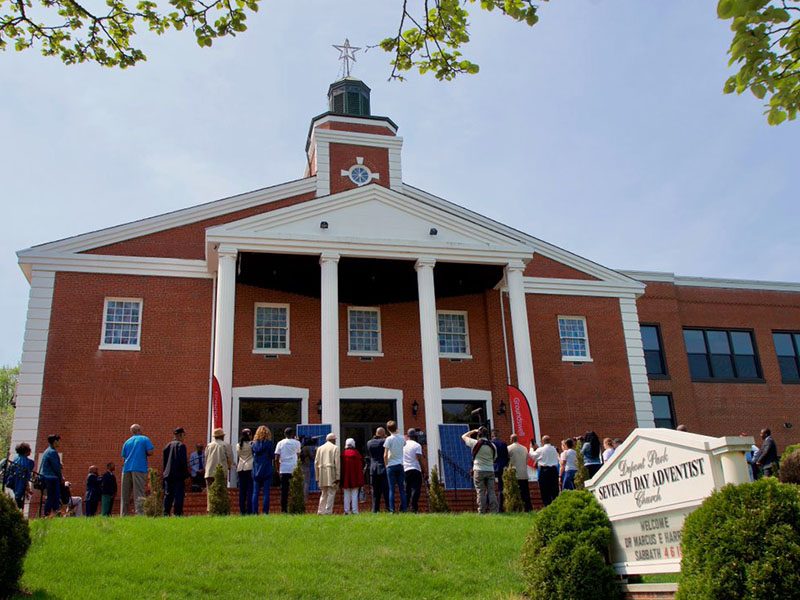 Solar panels are carried into the Dupont Park Seventh Day Adventist Church.