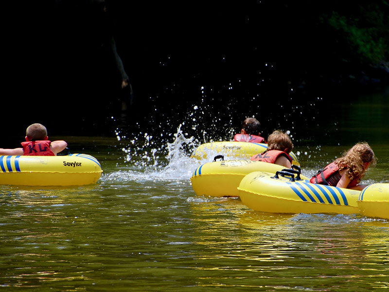 Children enjoy tubing along the Vermilion River.