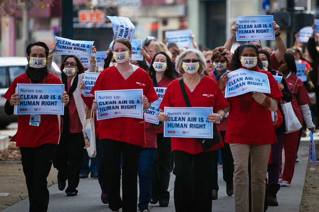 Members of the California Nurses Association march to a rally outside the hearing in Sacramento, CA, on February 2, 2015.
