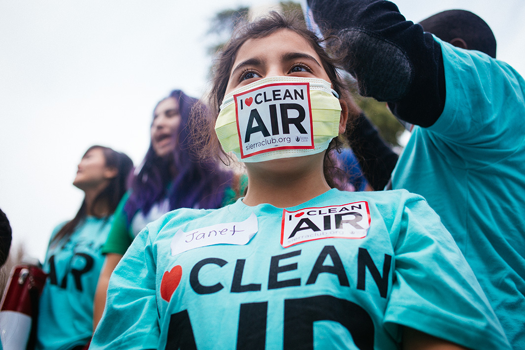 Janet Rodriguez, a fifth grader from Oakland, California, wears a symbolic mask. Rodriguez was one of many youths who attended the event to advocate for clean air.