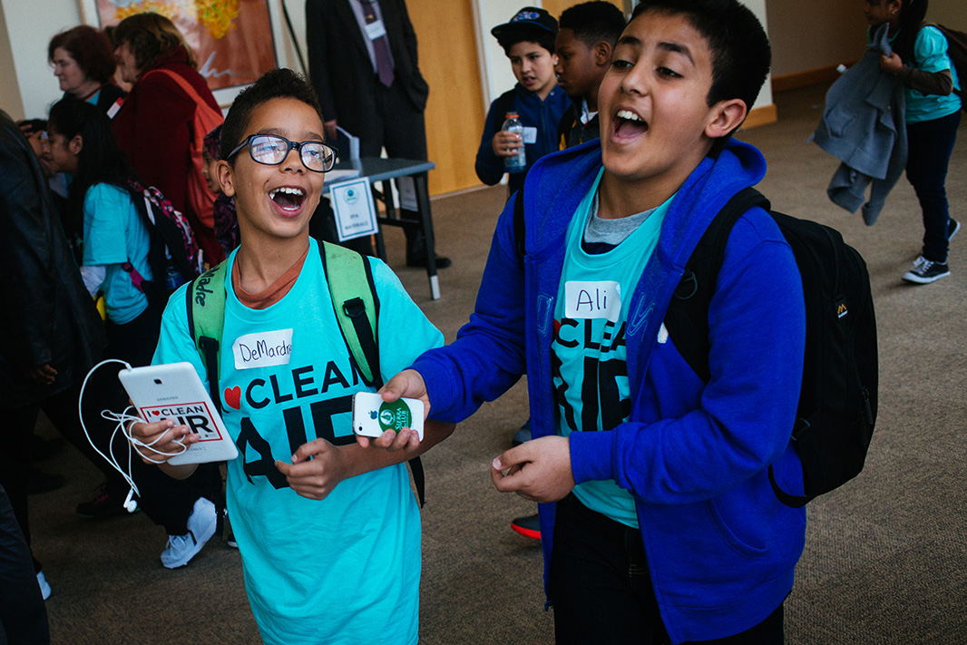 Fifth grader DeMardre Allen, left, shares a light moment with his friend Ali Ismael outside of the hearing.