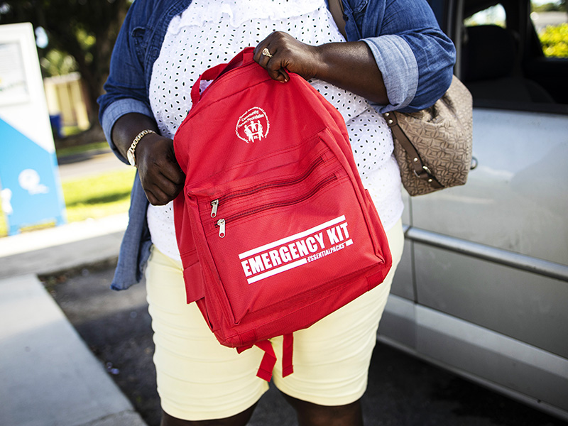 Crystal Johnson holds one of the emergency packs she has been distributing throughout her community.