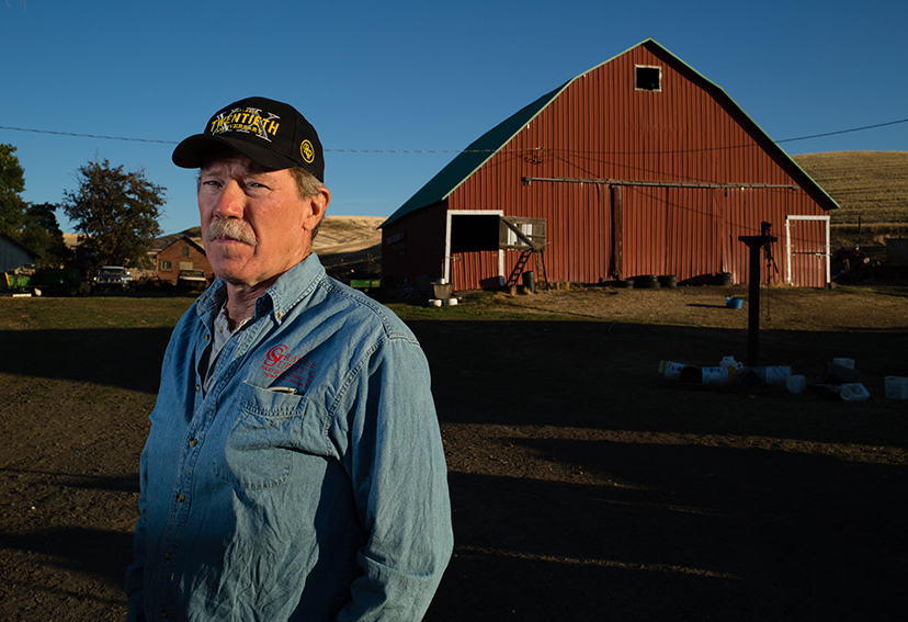 Jones stands in front of his barn, a centerpiece of one of the last family farms still operating in the area.