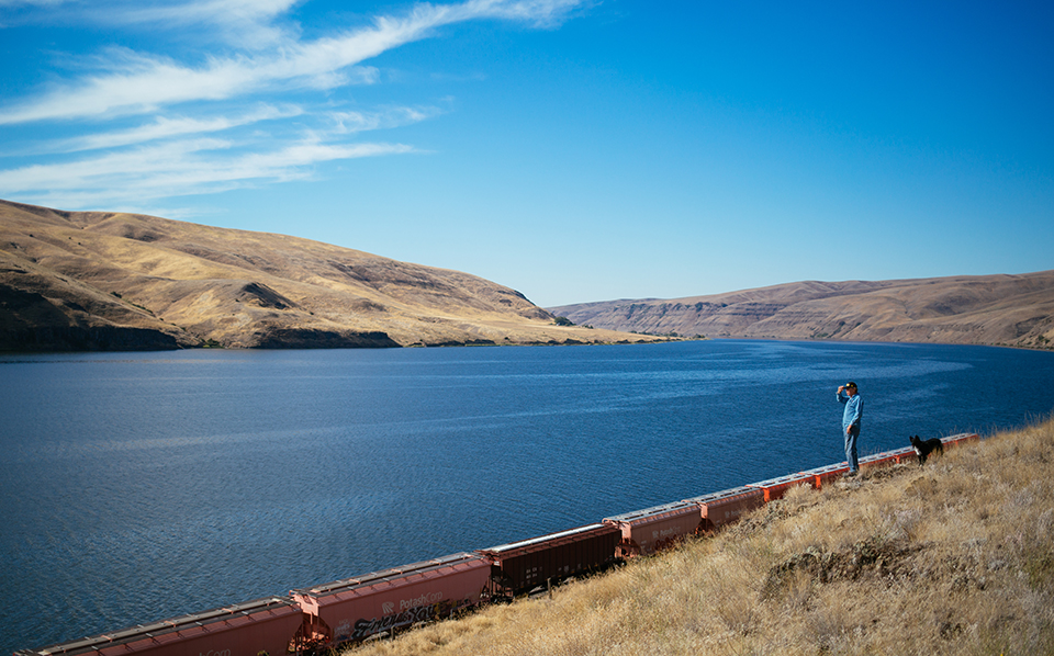 Jones looks out at the Snake River and the end of the railway line. He hopes the line will be extended so that farmers will have an alternative to river barges to transport their crops.