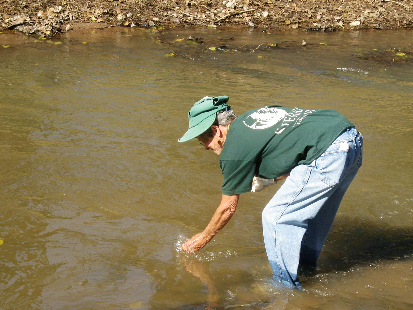 Tricia Gerrodette tests water quality in the San Pedro River.