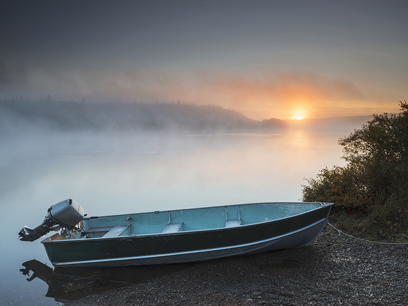 The sun rises over a skiff near Bristol Bay in Alaska.