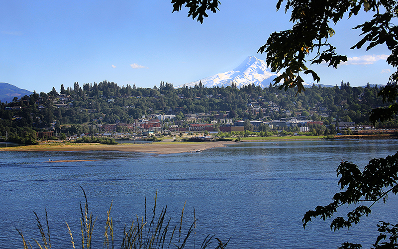 Mosier is not the only town along the Columbia River Gorge threatened by crude-by-rail. Railway tracks on both the Washington and Oregon sides of the river mean that other towns, such as scenic Hood River (pictured), are also at risk.