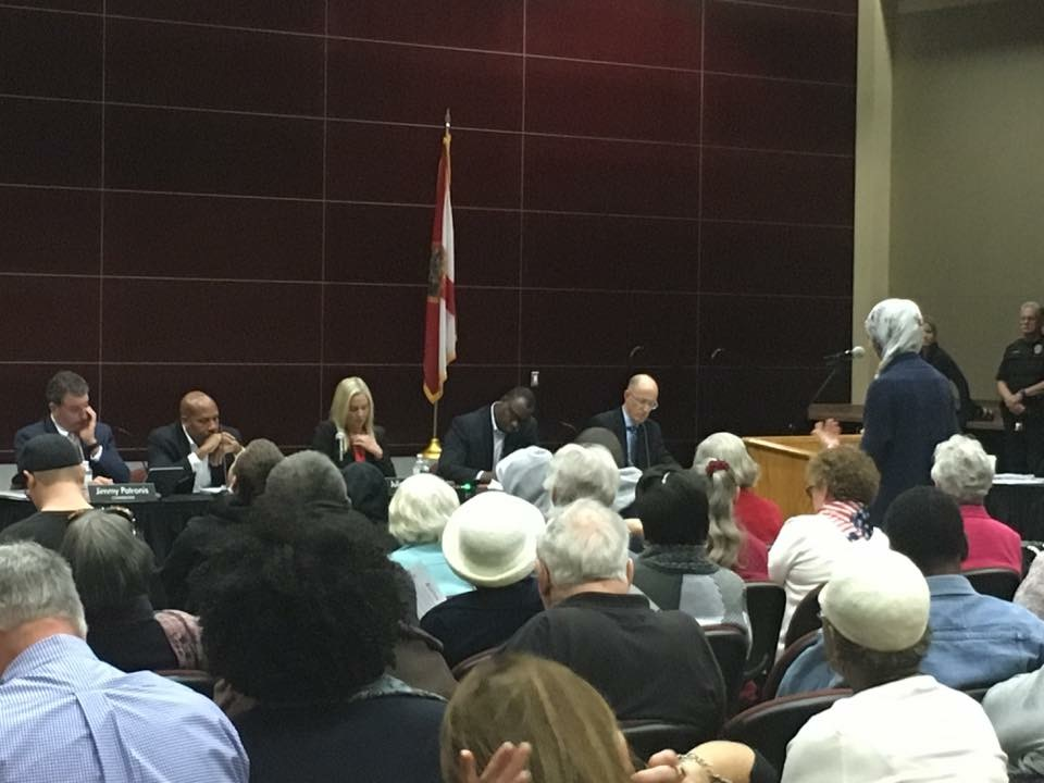 A member of the League of Women Voters of Florida speaks out against a proposed rate hike by Gulf Power at a Florida Public Service Commission hearing.