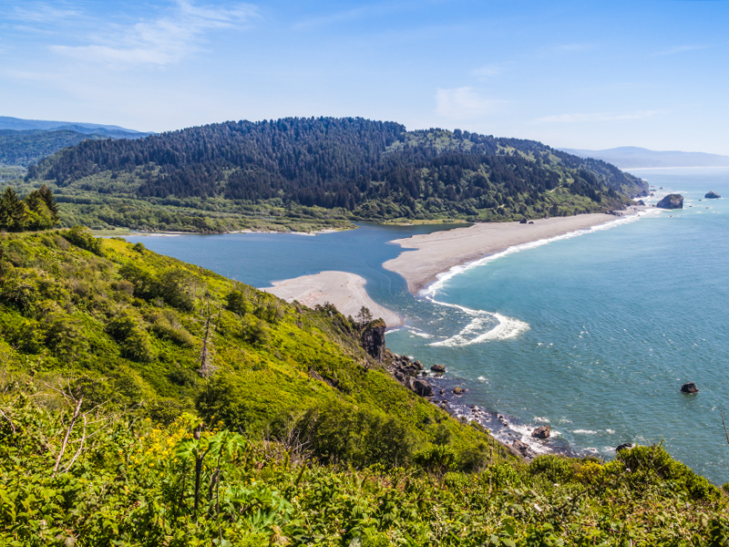 The Klamath River flows into the Pacific Ocean in Northern California.