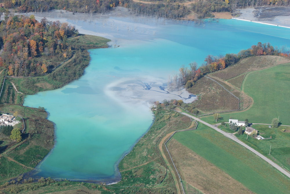 A portion of the nearly 3-square mile Little Blue Run coal ash impoundment in western Pennsylvania. The striking blue color results from chemicals suspended in the coal ash pond.