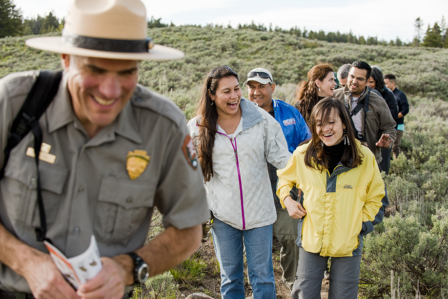 Summit attendees, including Earthjustice Sr. Legislative Representative Andrea Delgado (front-right), hike through Grand Teton National Park with a ranger.