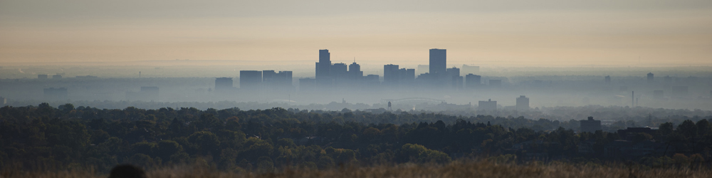 Air pollution hangs over the skyline in Denver, Colorado, where the Surwillo family currently lives.