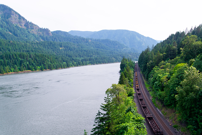 A train track passes through the Columbia River Gorge near the Crown Point Viewpoint.