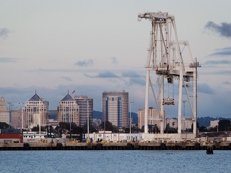 A crane looms over the Port of Oakland.