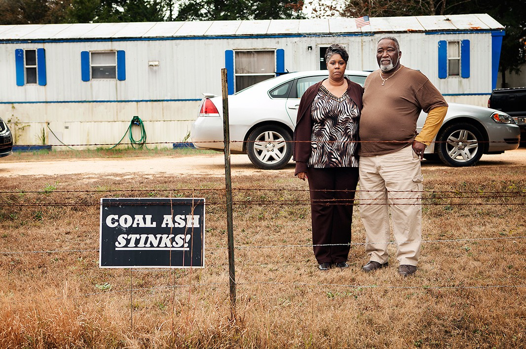 Annette Gibbs and her husband William stand in their front yard, which is near the Arrowhead Landfill.