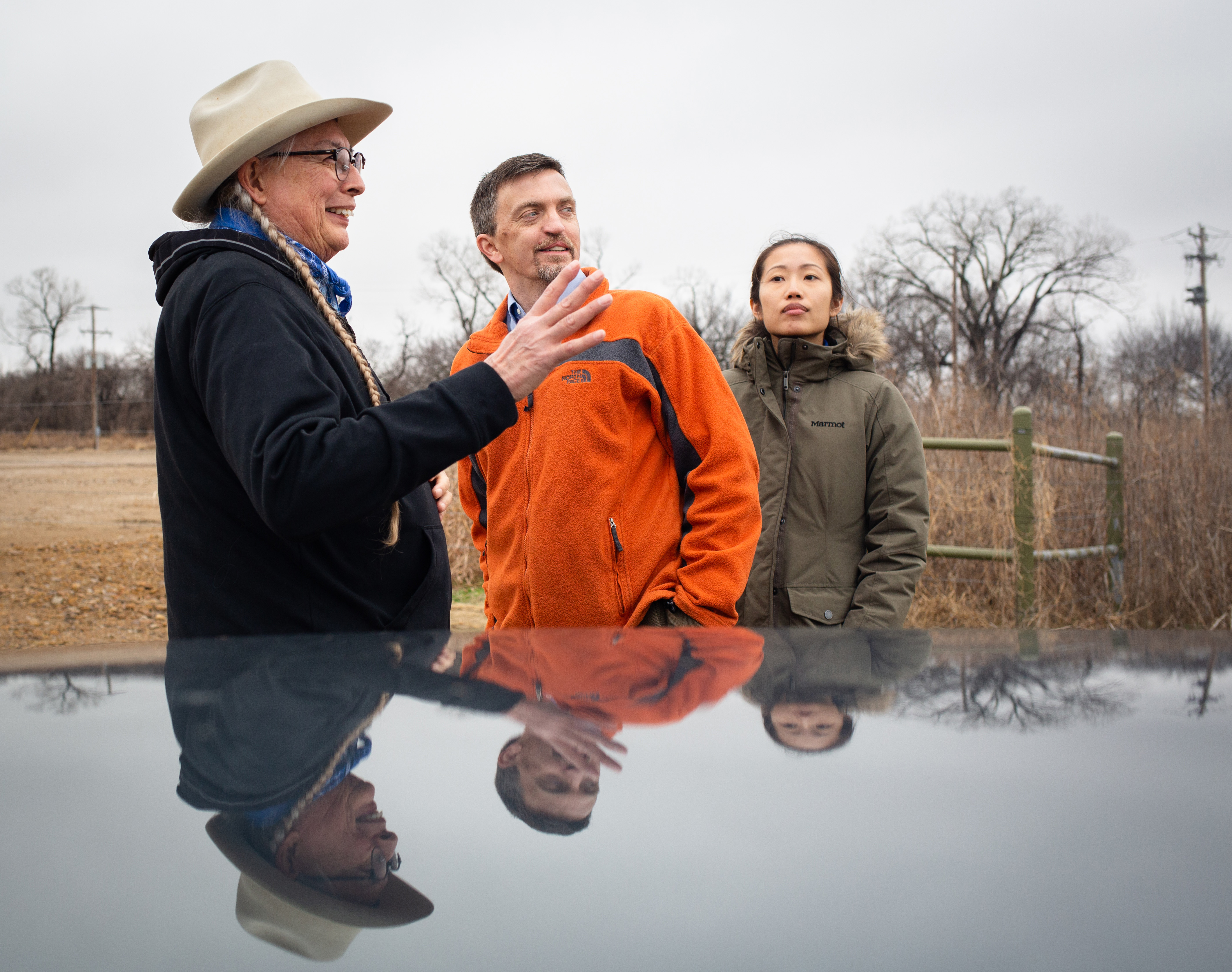 Walter Echo Hawk, left, gives a tour of fossil fuel drilling projects near his home to Earthjustice attorneys Michael Freeman and Yvonne Chi.