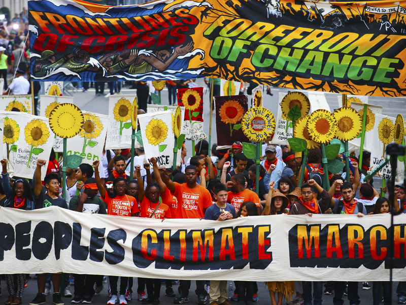 More than 100,000 people march through New York City as part of the People's Climate March