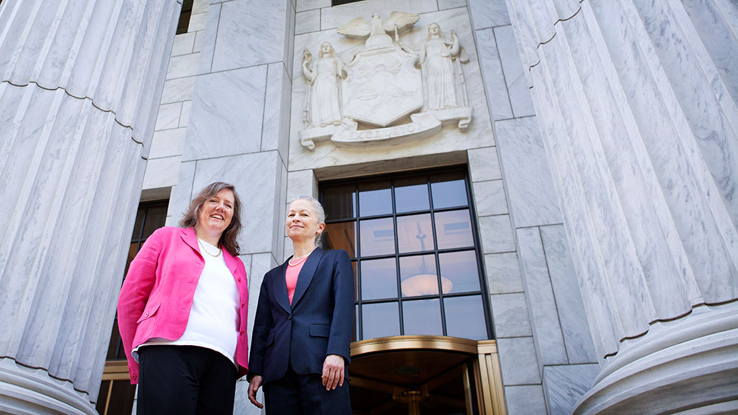 Helen Slottje and Deborah Goldberg stand on the steps of the Court of Appeals in Albany on June 3, 2014, shortly before oral arguments.
