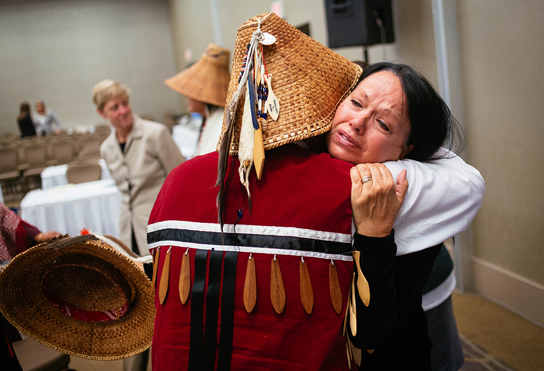 Tulalip tribal member Patti Gobin cries as she hugs her brother Glen Gobin after their testimony.