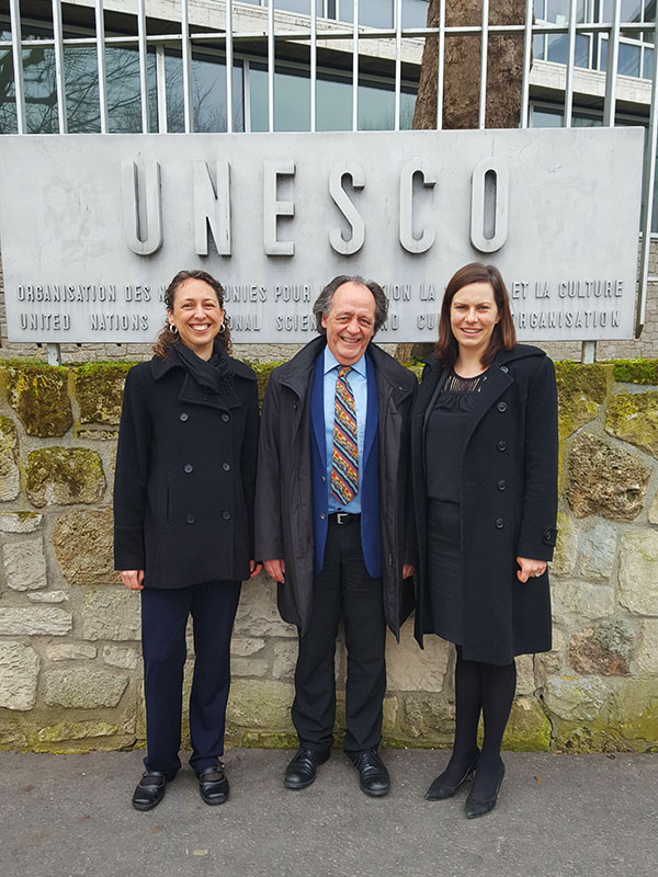 Earthjustice Senior Research and Policy Analyst Jessica Lawrence, Earthjustice Permanent Representative in Geneva Yves Lador, and Earthjustice Staff Attorney Noni Austin stand outside the United Nations Educational, Scientific and Cultural Organization building in Paris.