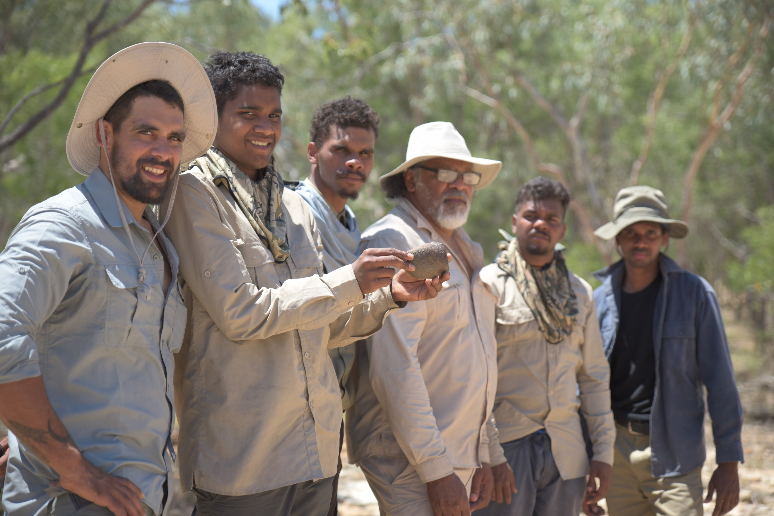Adrian Burragubba provides cultural teachings to Wangan and Jagalingou young men on their ancestral lands.