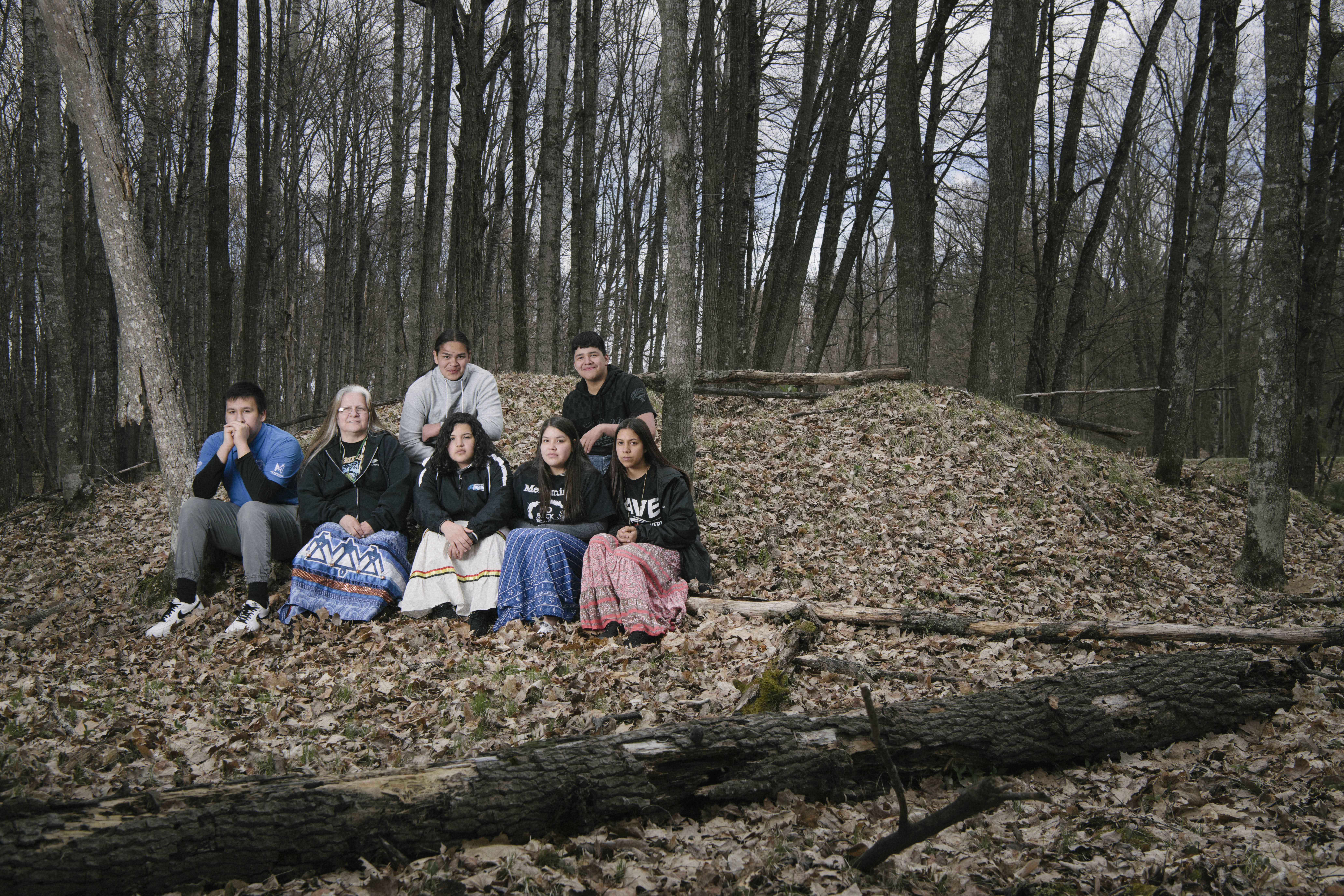 Teenagers at an ancient mound near the banks of the Menominee River.