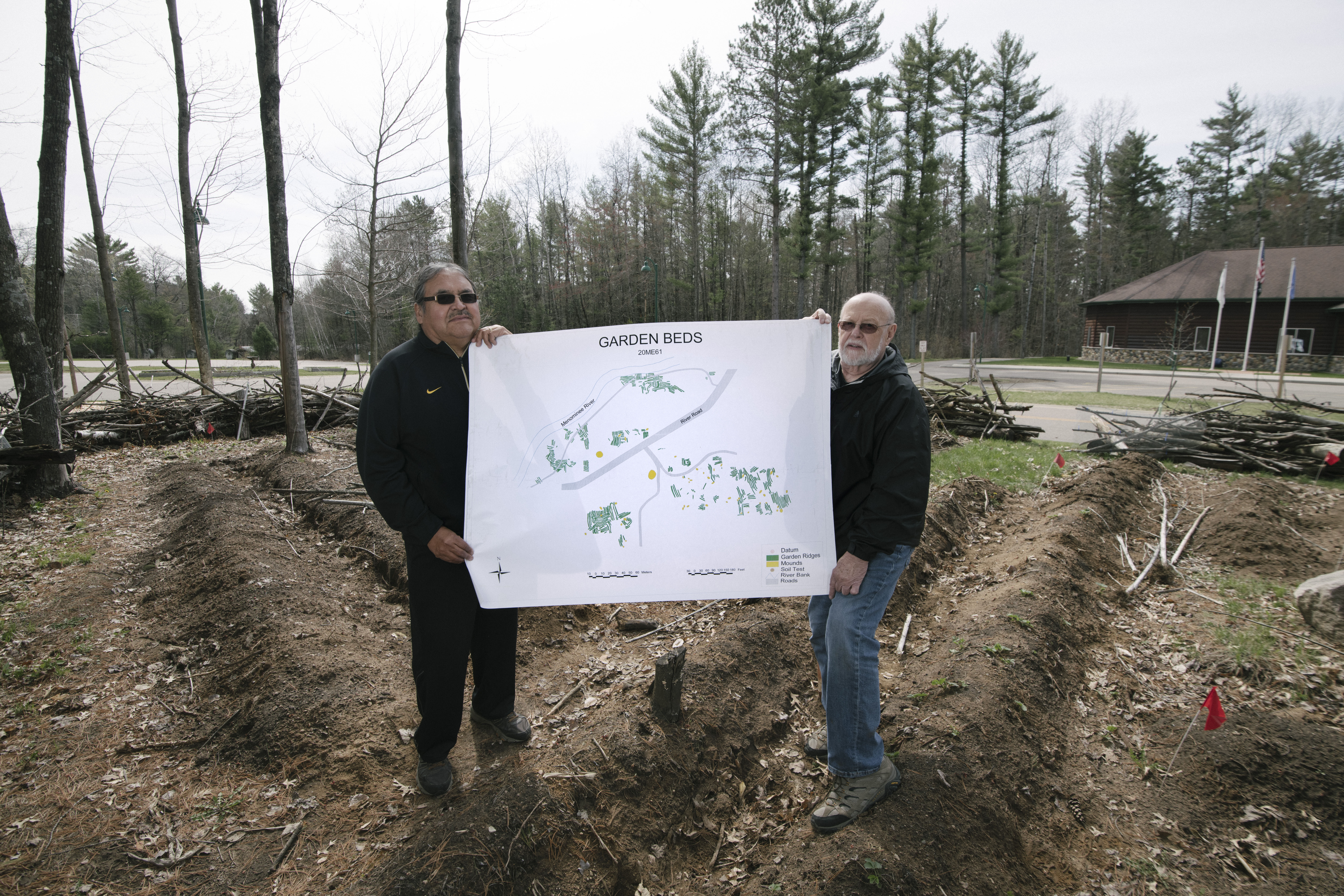David Grignon and David Overstreet stand in a replica garden they created to learn more about ancient agricultural techniques, following archaeologists' discovery of ancient raised garden beds in Menominee village sites.