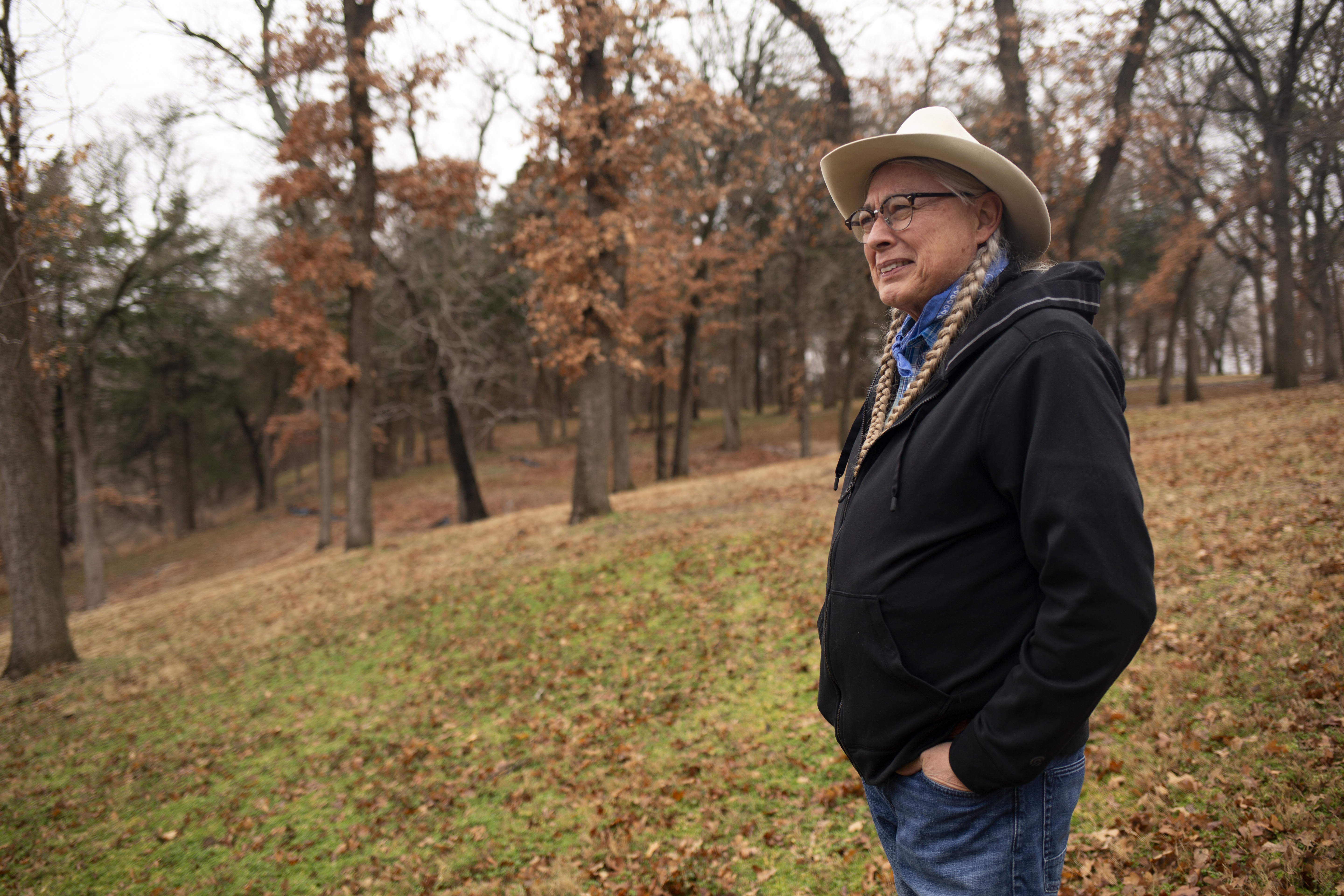 Walter Echo-Hawk stands on his land in Oklahoma.
