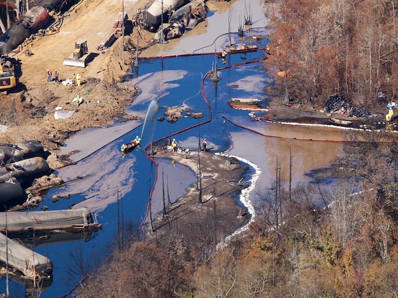 Aerial view of clean up after a Genesee & Wyoming train carrying North Dakota crude derailed near Aliceville, AL, in November 2014, exploding and burning for more than 18 hours. An estimated 748,800 gallons of oil spilled, including into surrounding wetlands. Four months later, oil was still oozing into the water.